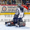 Drew Owsley blocks  the puck in mid air in the 1st period