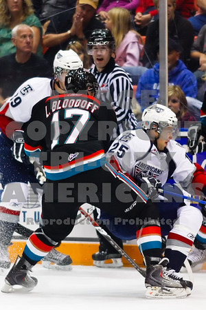 Americans Brock Sutherland #39 and Neal Prokop #25 struggle for the puck in the first period