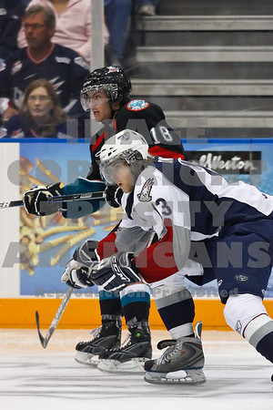 In the 3rd period Americans Sergei Drozd lookis to interceps a pass to rockets shane McColgan