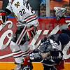 Brock Sutherland gets dumped to the ice by Winterhawk Nino Niederreiter