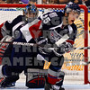 Goalie Drew Owsley and Neal Prokop defending the net
