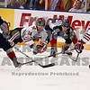 Americans Kruise Reddick and Brett Plouffe work to get puck control from Winterhawks Luke Walker and Chris Francis