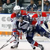 American Jordan Messier struggles with Chiefs Kyle Beach for control of the puck in front of the net