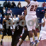 Albemarle's Mayn Francisco (23) shoots past Brooke Point's Mario Gill (5). photo Ashley Twiggs