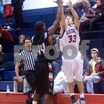 Albemarle's Dalton Stokes (33) attempts to shoot past Brooke Point's E.L. Smiling (44). photo Ashley Twiggs
