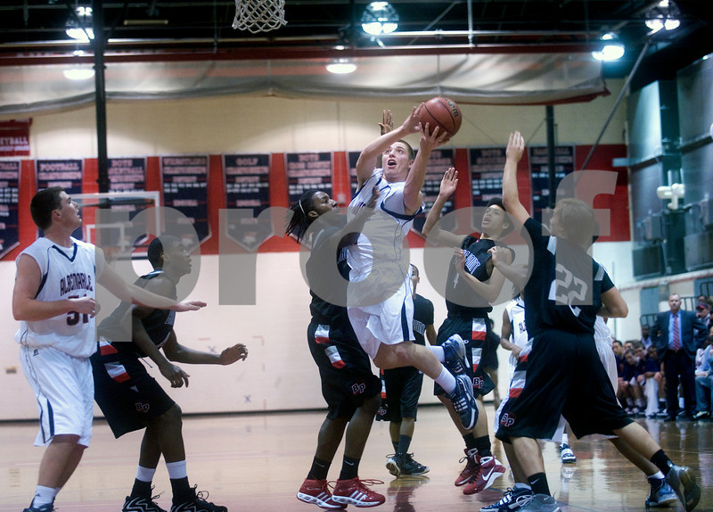 Albemarle's Andrew Frazier (21) attempts to shoot past Brooke Point's Phillip Holmes (24). photo Ashley Twiggs