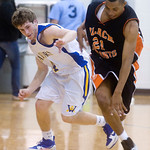Charlottesville's Maurice Jackson (21) takes the ball from Western's Stephen Schuler (4). photo Ashley Twiggs