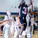 Charlottesville's Damion Morton (25) takes the ball to the hoop against Western. photo Ashley Twiggs