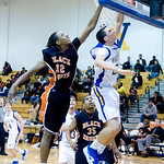 Western's Travis Hester (23) shoots as Charlottesville's Daquan Jones (12) attempts to block the shot. photo Ashley Twiggs