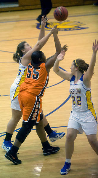 Western's Caryolyn Schneller, left, and Christine Fortner, right, try to take the ball from Charlottesville's Sydney Calloway. photo Ashley Twiggs