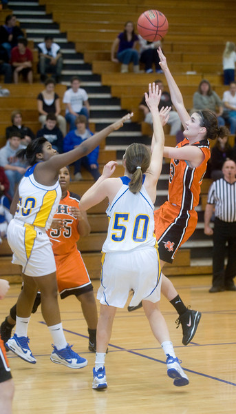 Charlottesville's Olivia Levine shoots as Western's Raven Ward, left, and Ellen Shaffrey try to block the shot. photo Ashley Twiggs