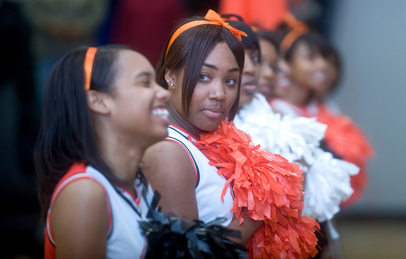 Charlottesville High School cheerleaders line the court before a basketball game against Madison County High School. photo Ashley Twiggs