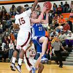 Charlottesville, Dec. 2, 2009 - Charlottesville's Devin Turner (15) tries to block a shot by Madison's David Falk (23). photo Ashley Twiggs