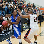 Charlottesville's Maurice Jackson (21) guards Madison's A.J. Butler (25). photo Ashley Twiggs