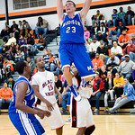 Charlottesville, Dec. 2, 2009 - Charlottesville's Devin Turner (15), center, watches as Madison's David Falk (23) dunks the ball during a game at Charlottesville. photo Ashley Twiggs