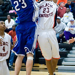 Dec. 2, 2009 - Charlottesville'e Rickquan Jones gets blocked by Madison's David Falk. photo Ashley Twiggs