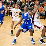 Dec. 2, 2009 -  Left to right, Madison's David Falk (23), Charlottesville's Rickquan Jones (23), Madison's Logan Terrell (43) and Charlottesville's Daquan Jones (12) watch the ball during a game at Charlottesville. photo Ashley Twiggs
