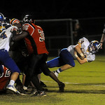 Western's Adam Diehl (24) carries the ball over the line for a touchdown against Charlottesville. photo Ashley Twiggs