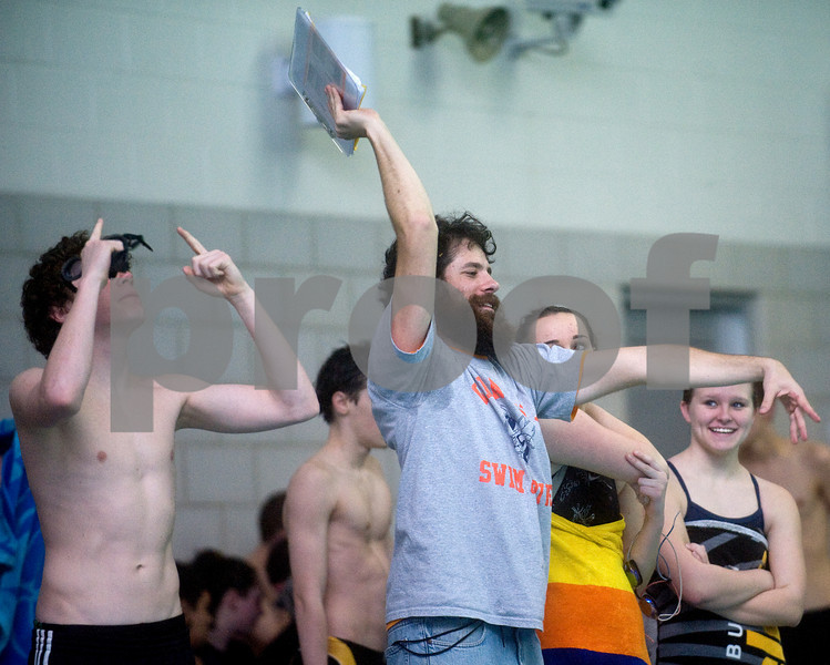 Feb. 12, 2010 - Coaches and teammates cheer from the end of the pool during the JD Championships on Friday night at FUMA. photo Ashley Twiggs