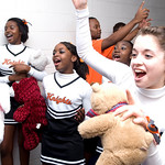 The Charlottesville High School cheerleaders cheer as all of the teams line up in the hallway. photo Ashley Twiggs