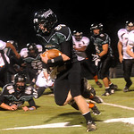 Louisa's Dillon Hollins (33) carries the ball against Charlottesville. <br /> photo Ashley Twiggs