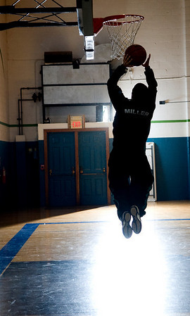 A Miller player warms up before a game against Woodberry Forest. photo Ashley Twiggs