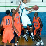 Miller's Mychal Parker (33) heads for the basket while Woodberry's CJ Prosise (3) tries to block the shot. photo Ashlely Twiggs