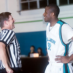 Dec. 4, 2009 - Miller's Hippolyte Tsafack (32) jokes around with a referee during half time. <br /> photo Ashley Twiggs