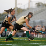 Monticello's Taylor Jerrell (14), left, and Louisa's Hali Goad (9) battle for possession of the ball during a game at Monticello. photo Ashley Twiggs