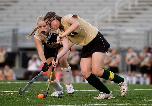 Sept. 14, 2009, Charlottesville, Va. -Monticello's Lindsey Martin (3), left, tries to take the ball from Louisa's Michelle Best (22). photo Ashley Twiggs