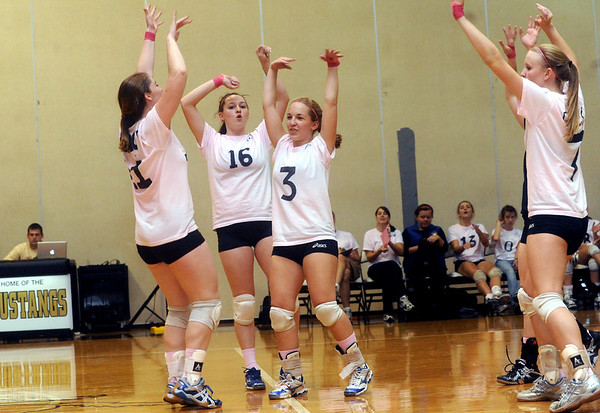 Western celebrates a point against Monticello. photo Ashley Twiggs