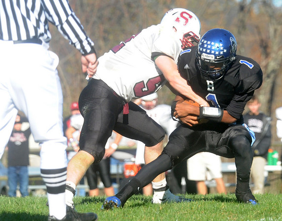 STAB's Brandon Spitzer tackles for Blue Ridge's Andre Roberts. photo Ashley Twiggs