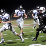 Lee Coppock (15) carries the ball as Mitchell Birckhead (92) fends off STAB's Charles Sipe. photo Ashley Twiggs
