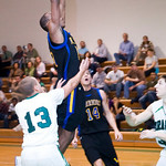 Western's Dante Crawford dunks the ball during a game against Monroe. photo Ashley Twiggs