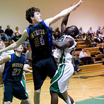 Western's Ben Tuner (24) blocks a shot by Monroe's Markees Towels (23). photo Ashley Twiggs