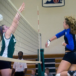 Western's Ana Asher, right, returns the ball past WIlliam Monroe's Sarah Moyer. photo Ashley Twiggs