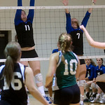 Western's Chastity Lacy, left, and Kristen Pack, right, attempt a block against William Monroe. photo Ashley Twiggs