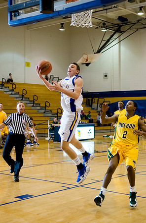 Western's Christian Pierce (14) attempts a shot as Nelson's Quincy Murphy (2) looks on. photo Ashley Twiggs