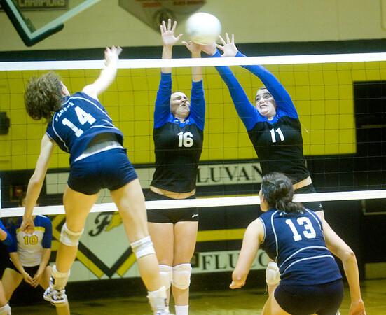 Western Albemarle's Amanda Gough (16) and Chastity Lacy (11) try to block a ball by Flucos' Amanda Kline. photo Ashley Twiggs
