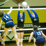 Western Albemarle's Amanda Gough (16) and Chastity Lacy (11) try to block a ball by Flucos' Amanda Kline. photo Ashley Twiggs
