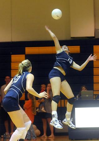 Flucos' Kayla Walker returns the ball to Western Albemarle. photo Ashley Twiggs