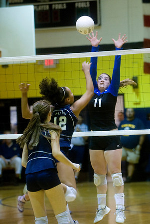 Western Albemarle's Chastity Lacy (11) comes to the net as Flucos' Mia Loyd (12) returns the ball. photo Ashley Twiggs