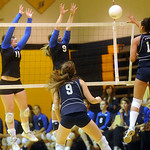 Western Albemarle's Chastity Lacy (11) and Sarah Harper (9) try to block as Flucos' Samantha Toy (9) and Mia Loyd (12) return the ball. photo Ashley Twiggs