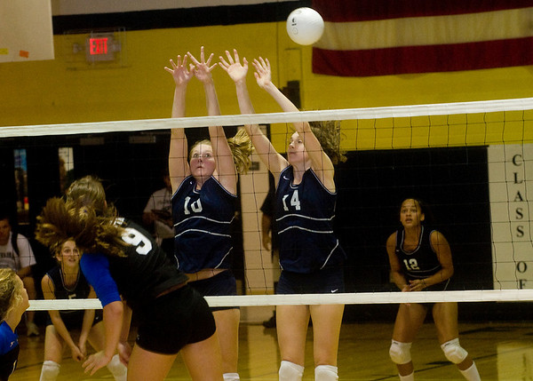 Flucos' Hannah Miller (10) and Amanda Kline (14) try to block a shot by Western Albemarle's Sarah Harper (9). photo Ashely Twiggs