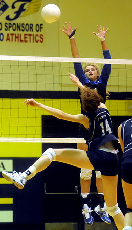 Western Albemarle's Ana Asher (1) tries to block a return by Amanda Kline (14) during a game at Fluvanna. photo AShley Twiggs