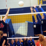 Western's Amanda Gough (16) and Chastity Lacy (11) attempt to block a return by Sherando's Ashleigh Tanis. photo Ashley Twiggs
