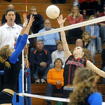 Western's Ana Asher tries to block a ball by Sherando's Taylor Henshaw. photo Ashley Twiggs