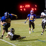 Western's Dom Losco (25) is forced out of bounds by Louisa's Elijah Payne (4). photo Ashley Twiggs