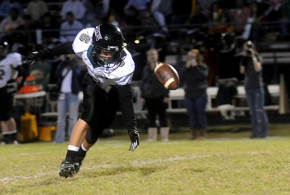 Louisa's Clark Wilson (5) fumbles the ball during a game against Western. photo Ashley Twiggs