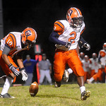 Orange's Tyrone Ellis, 2, and Amir Waller, 10, fumble a handoff during a game at Western. The ball was recovered by Western. photo Ashley Twiggs